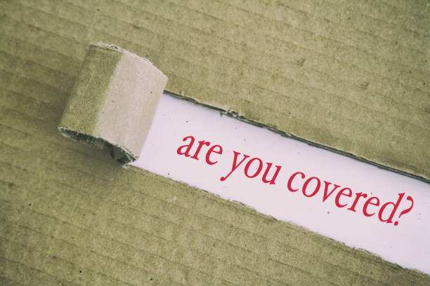are you covered? are you covered? written under torn paper. covering stock pictures, royalty-free photos & images