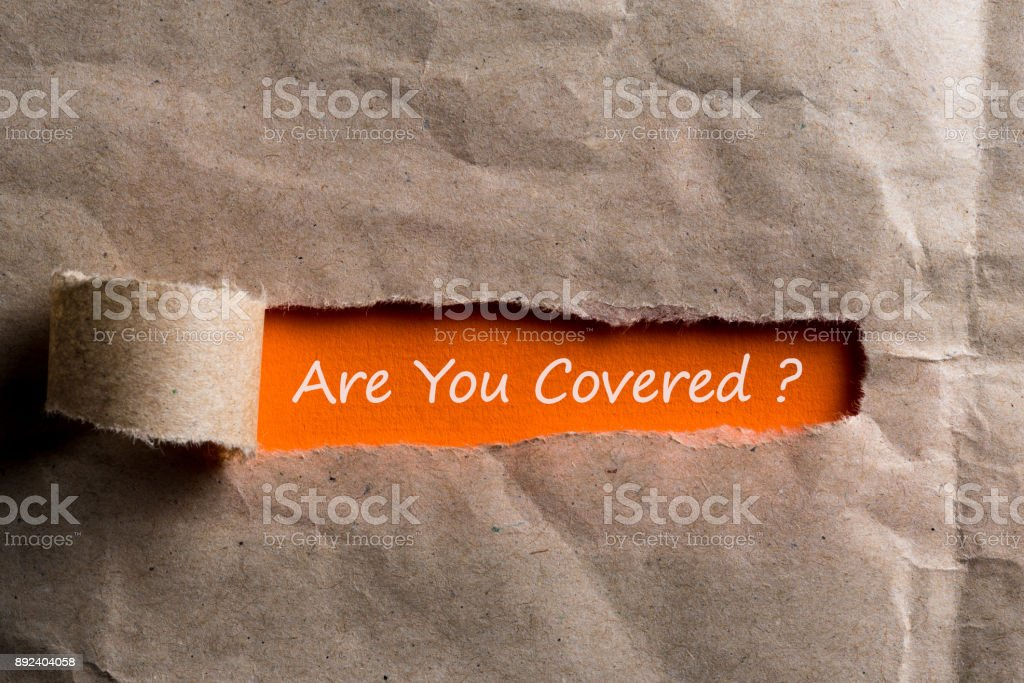 Are you covered - question written on orange paper in brown envelope stock photo