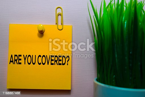 istock Are You Covered? text on sticky notes isolated on office desk 1168887468