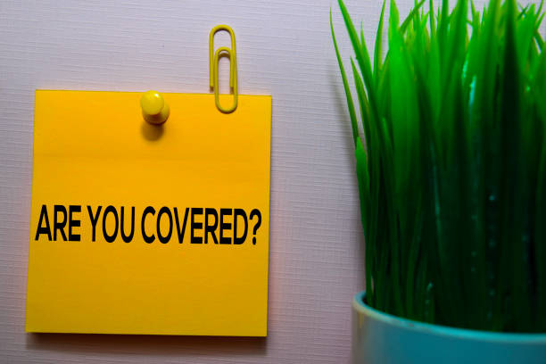 Are You Covered? text on sticky notes isolated on office desk stock photo
