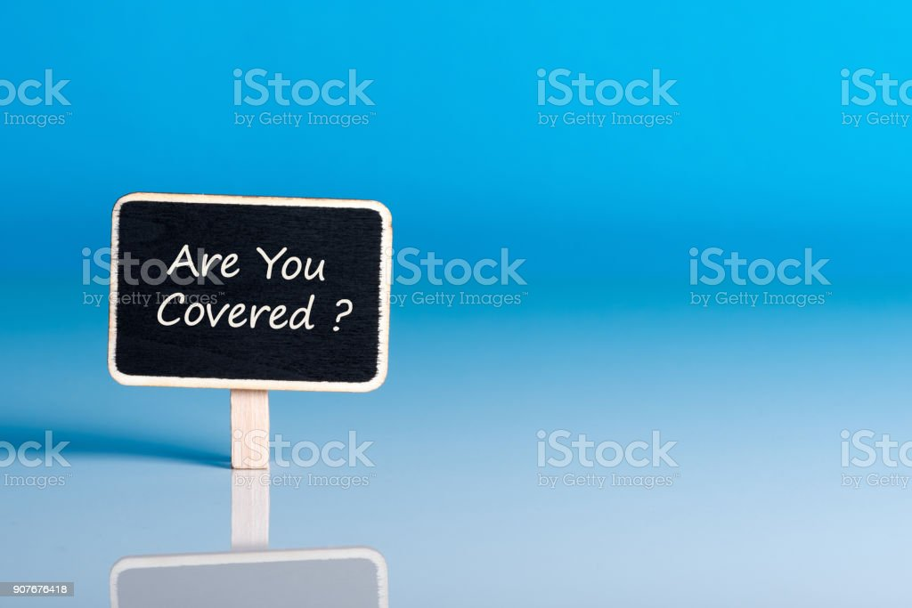 Are you Covered? written on a board at blue background, mockup with empty space for text, template stock photo