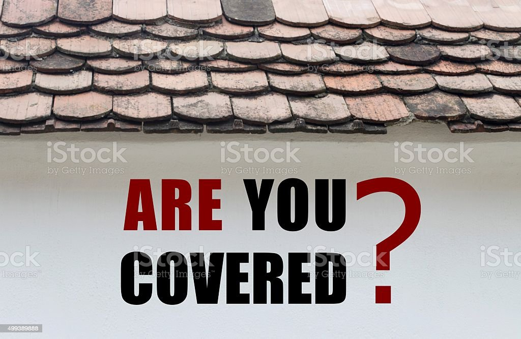Are you covered written over old house wall stock photo