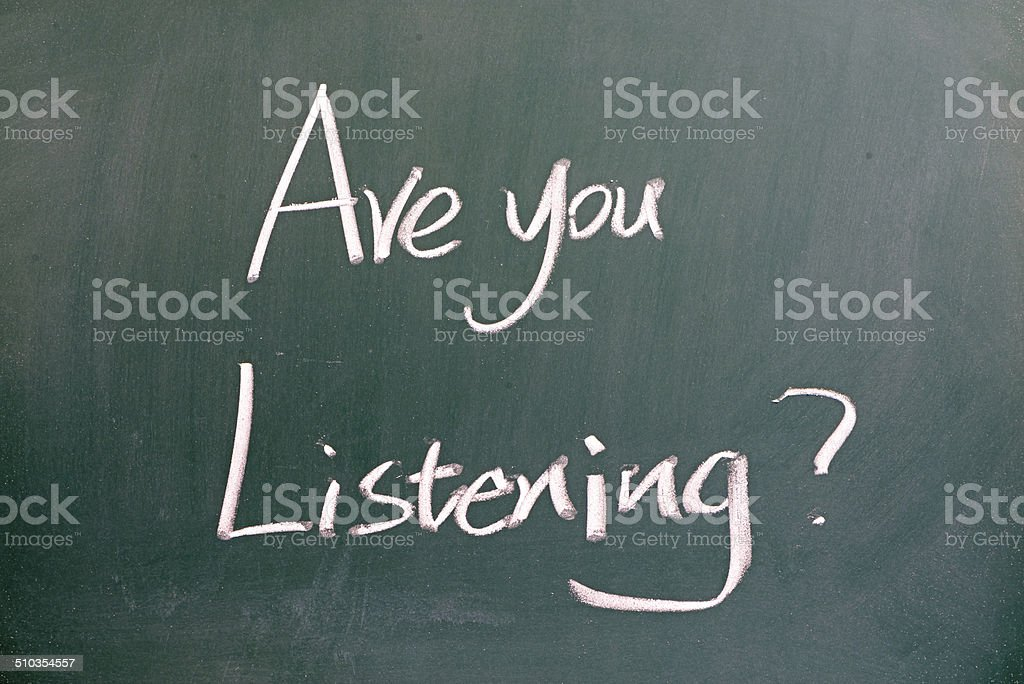 Are you listening written on blackboard stock photo