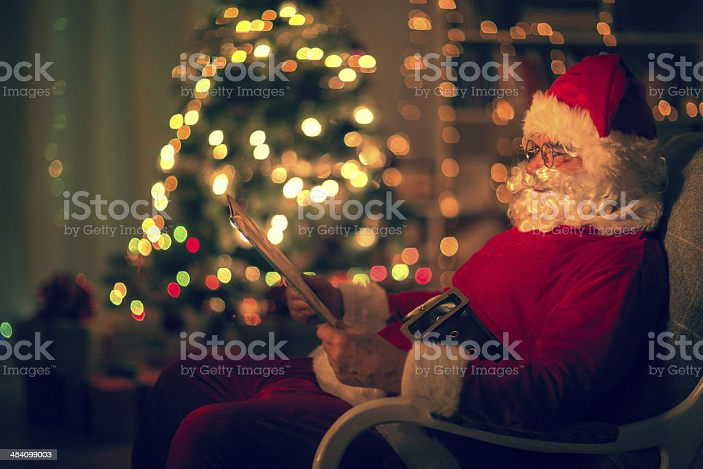 Santa reading a list of presents