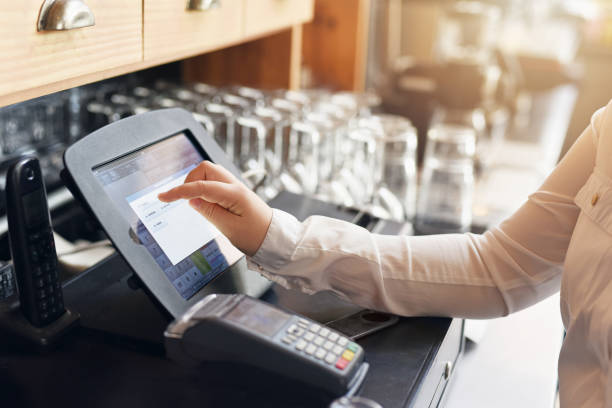 Are you ready for the bill? Shot of an unrecognizable woman punching in a order for a customer cash register stock pictures, royalty-free photos & images