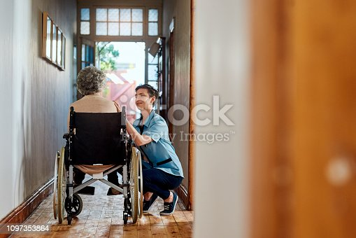 Shot of a nurse caring for a senior patient in a retirement home