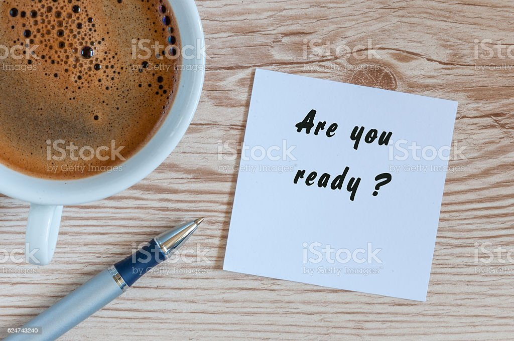 Are you ready - question in notepad near morning cup stock photo