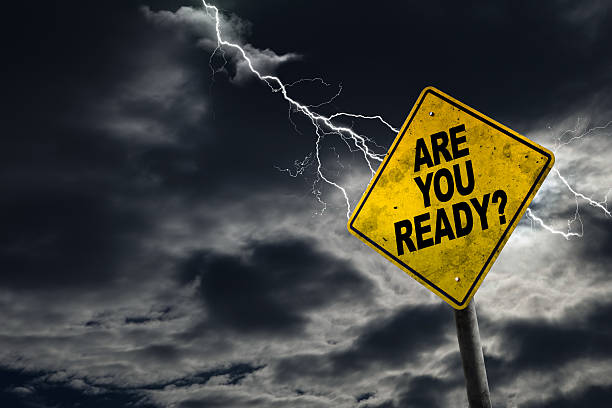 Are You Ready Sign With Stormy Background Are You Ready sign against a stormy background with lightning and copy space. Dirty and angled sign adds to the drama. extreme weather stock pictures, royalty-free photos & images