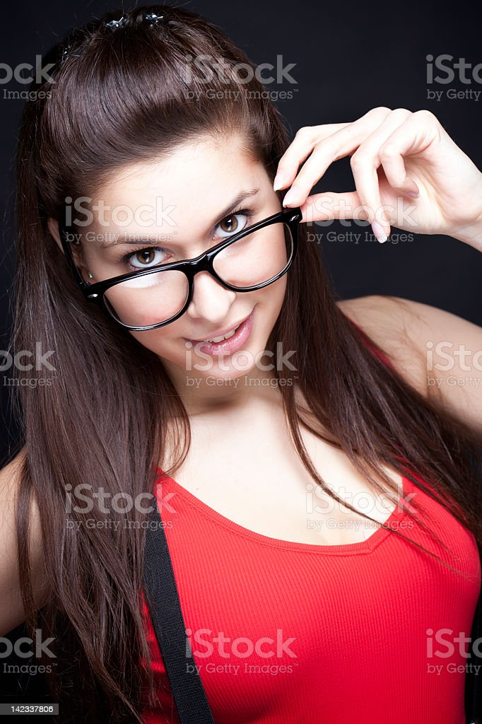 Are You Smart Enough For Me? Geek Woman In Red stock photo