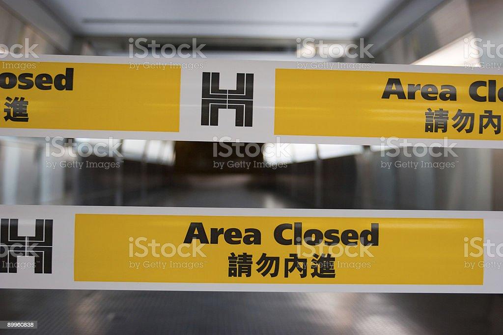 Area Closed - yellow tape  macro stock photo