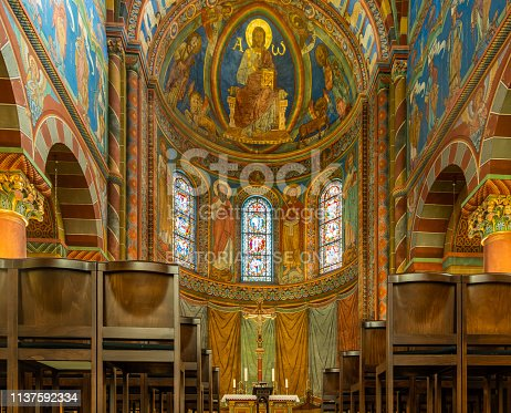 Königslutter, Germany, January 18., 2019: Area of the altar in the Imperial Cathedral with the front rows of chairs and the impressive ceiling painting