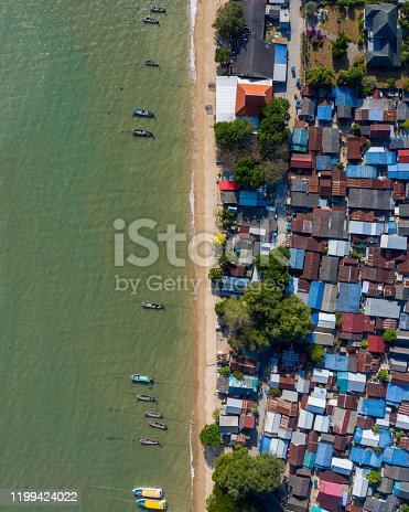 Areal view of coloured houses in a fishing village, photographed in Phuket Thailand