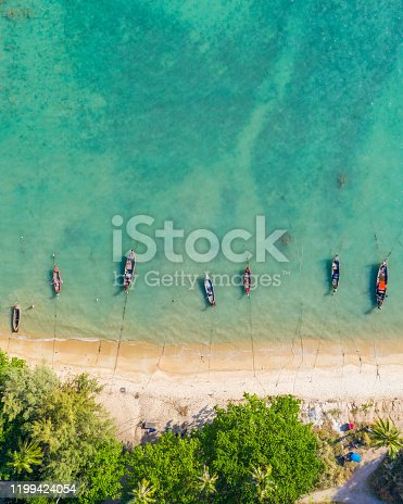 Areal view of a beach with fishing boats photographed in Phuket, Thailand