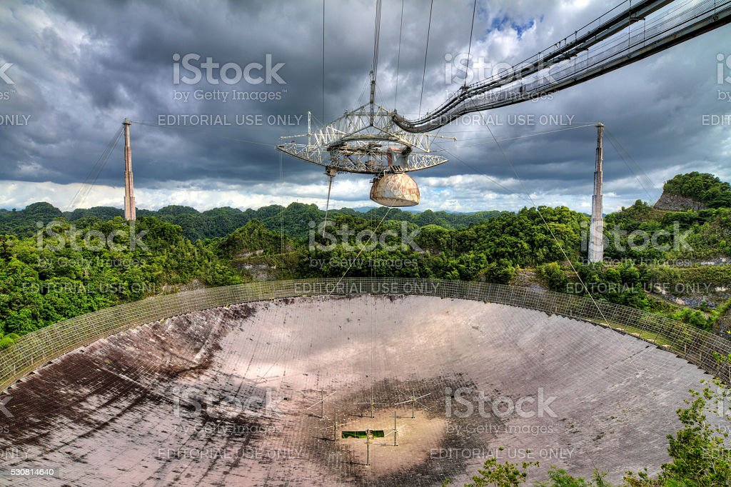 Arecibo jungle clouds receiver stock photo