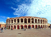 Verona,Italy - August 29, 2013: Beautiful architecture of UNESCO world heritage site city Verona. Tourists and locals visiting Arena di Verona and Piazza Bra.
