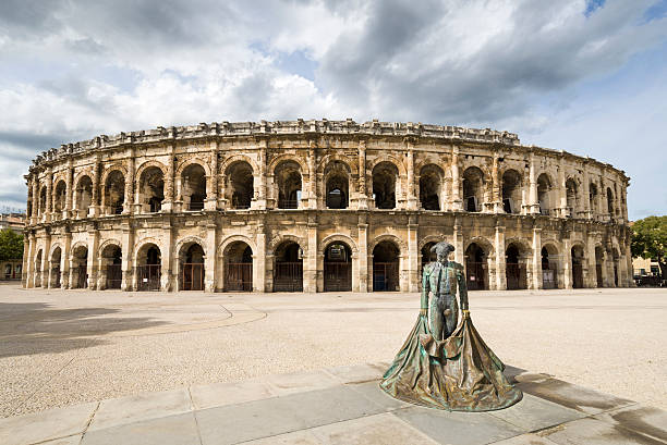 Arena of Nimes Built around AD 70, the  arena of Nimes is one of the best prepared roman amphitheatres in the world.. amphitheater stock pictures, royalty-free photos & images