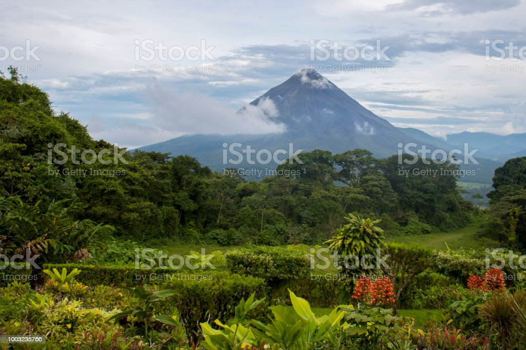Arenal Volcano background and Jungle foreground stock photo