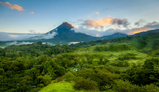Arenal Volcano, Costa Rica Scenic view of Arenal Volcano in central Costa Rica at sunrise central america stock pictures, royalty-free photos & images