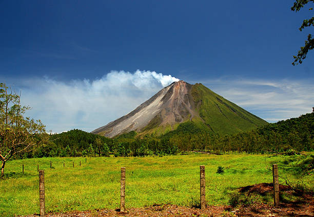 Arenal Volcano - Costa Rica The Classic Cone Shape of Arenal Volcano in Costa Rica. arenal volcano stock pictures, royalty-free photos & images