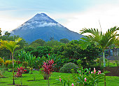 A lush garden in La Fortuna, Costa Rica with Arenal Volcano in the background.