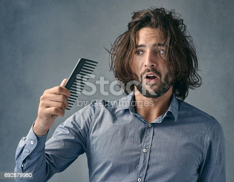 istock Aren't you suppose to fix the mess on my head? 692879980