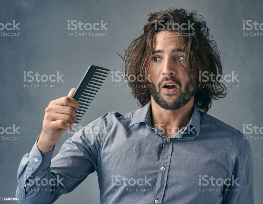 Aren't you suppose to fix the mess on my head? stock photo
