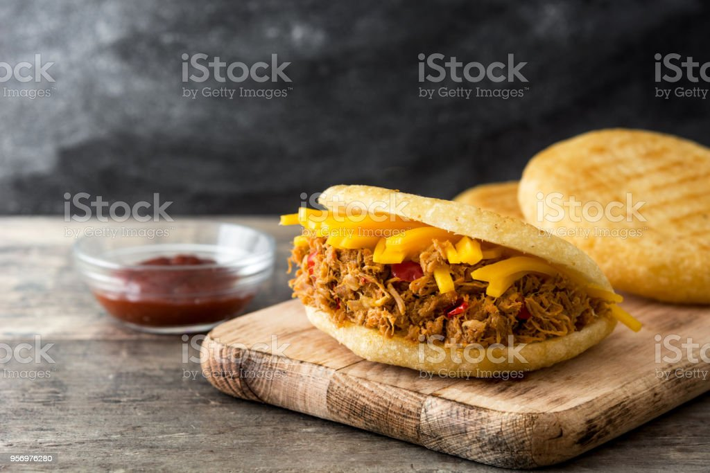 Arepa with shredded beef and cheese stock photo
