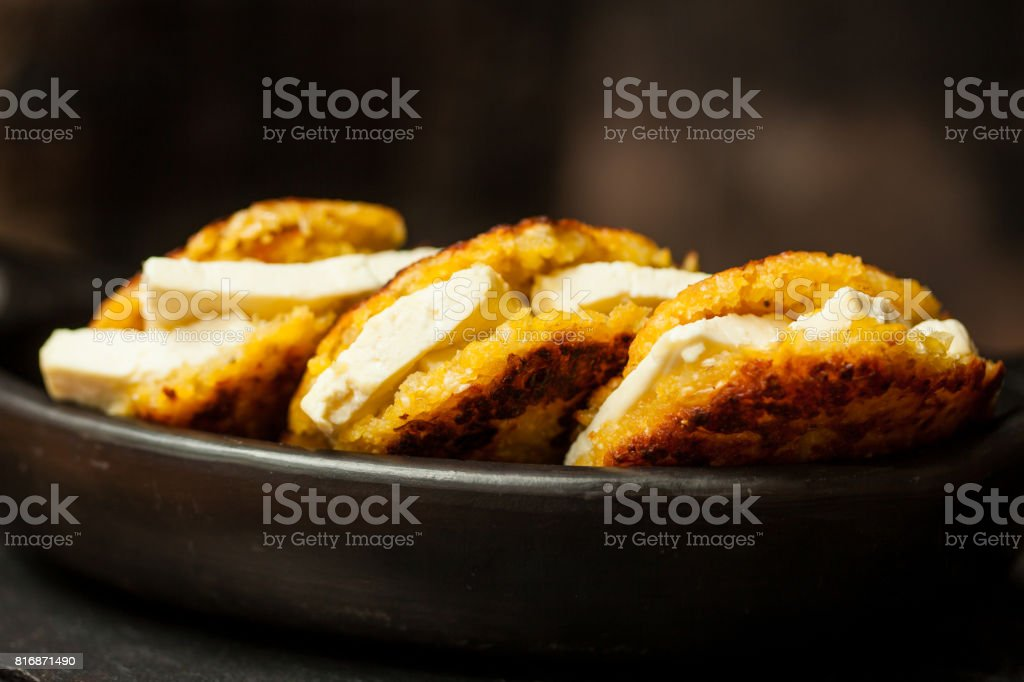 Arepas de choclo filled with white cheese stock photo