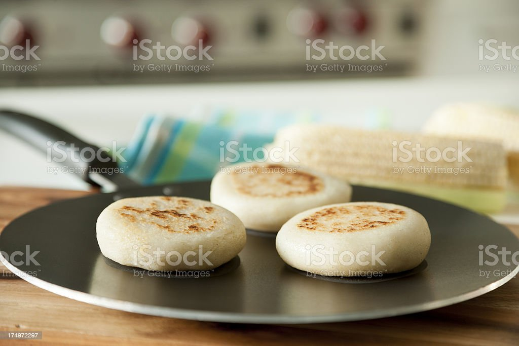 Arepas in a pan stock photo