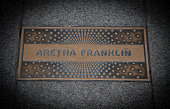 New York City, United States - September 3, 2014: Aretha Franklin paving slab in front of famous Apollo theatre in Harlem New York City