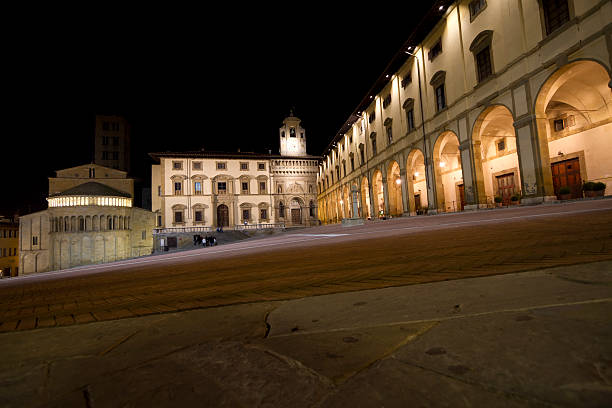 """Arezzo by night , Piazza Grande (Tuscany,Italy) """"The first draft of the Piazza Grande (Arezzo, Tuscany) dates from the year 1200 AD on an area much larger than at present. The current form of the square dates back to 1500 AD."""" piazza grande stock pictures, royalty-free photos & images"""