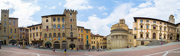 Arezzo Piazza Grande panoramic Arezzo, Italy - August 1, 2016: The Piazza Grande square, located in the old town of Arezzo, Tuscany, Italy. piazza grande stock pictures, royalty-free photos & images