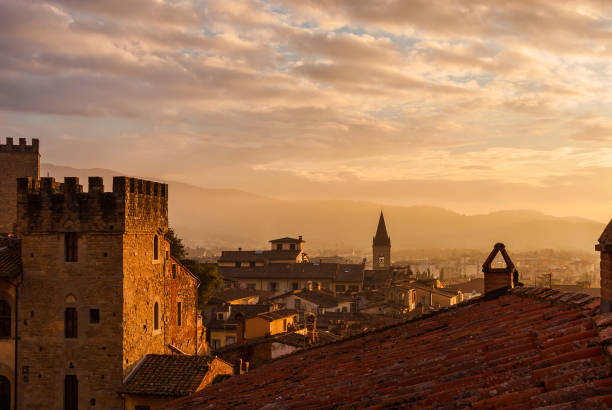 Arezzo sunset skyline with ancient buildings View of Arezzo historic center sunset skyline with old medieval towers, churches and mist arezzo stock pictures, royalty-free photos & images