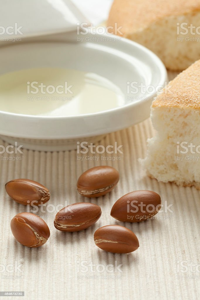 Argan nuts and oil stock photo