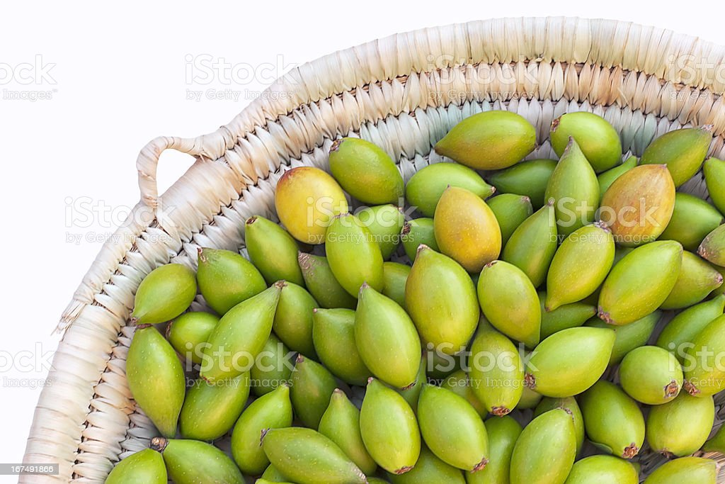 Argan nuts in basket. stock photo