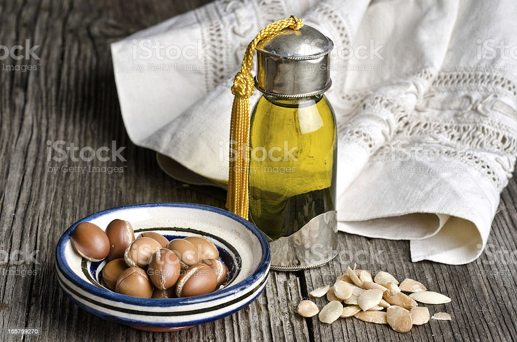 Argan oil and fruit Bottle of argan oil and argan fruit. Argan oil is used for skincare products. Argan Oil Stock Photo