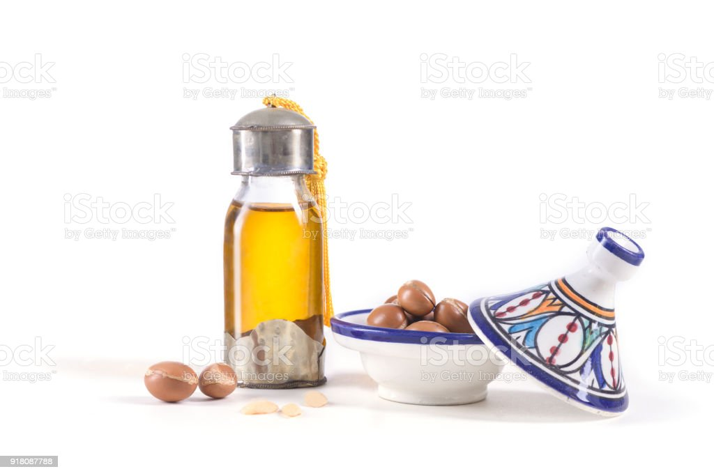 Argan oil and fruits on white stock photo