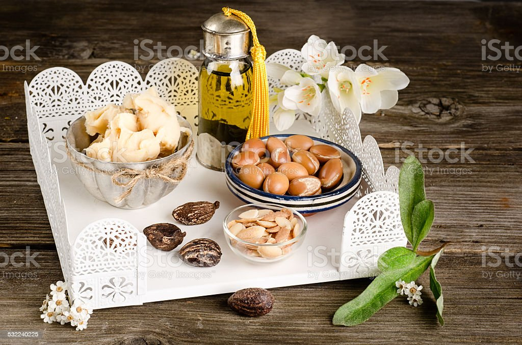 Argan oil and fruits with Shea butter and nuts stock photo