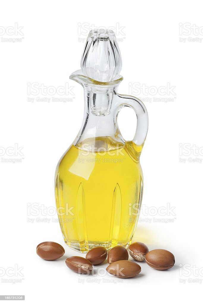 Argan oil and nuts stock photo