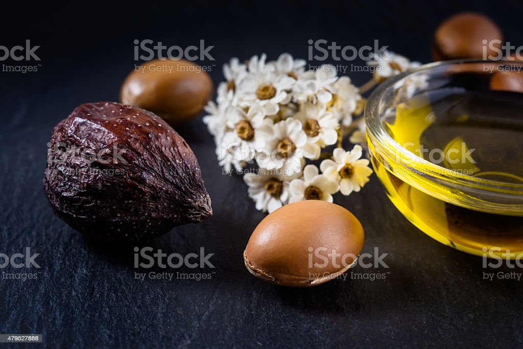 Argan seed and fruit with argan oil stock photo