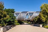 MADRID, SPAIN -  AUGUST 16, 2020: arganzuela bridge in madrid rio park, designed by dominique perrault, madrid, spain.