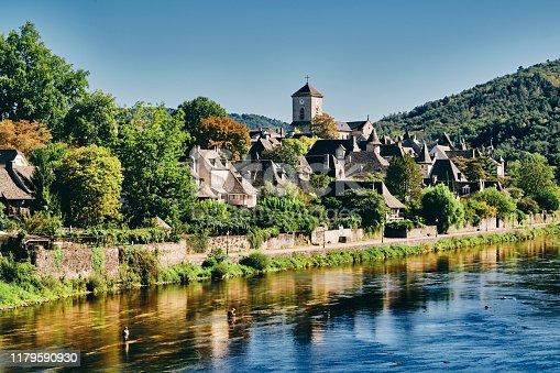 istock Argentat village south side of river, Dordogne, France 1179590930