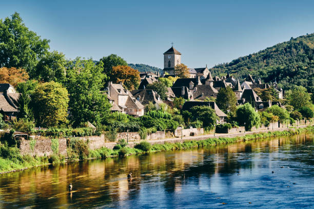 Argentat village south side of river, Dordogne, France stock photo