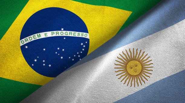 Argentina and Brazil two flags together realations textile cloth fabric texture stock photo
