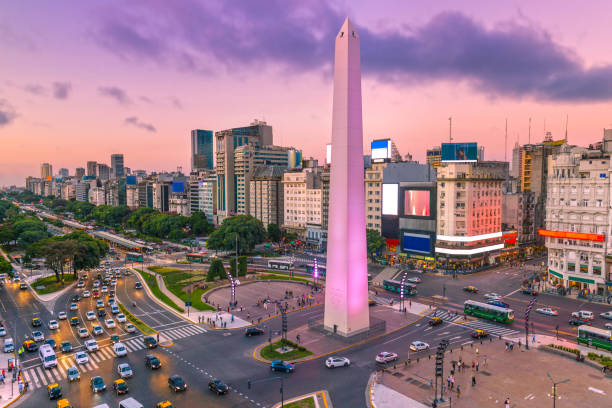 Argentina Buenos Aires dawn at center with rush hour Plaza de la Republica in the centre of Buenos Aires with the Obelisco, one of the main symbols of the capital of Argentina at dawn with heavy traffic Argentina stock pictures, royalty-free photos & images