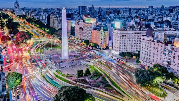 Argentina Buenos Aires downtown with traffic cars at night arround the Obelisco Argentina Buenos Aires downtown with traffic cars at night arround the Obelisco Argentina stock pictures, royalty-free photos & images