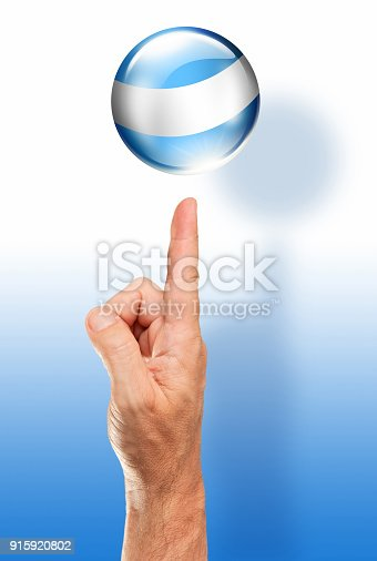 istock Argentina button flag pointing with human hand 915920802