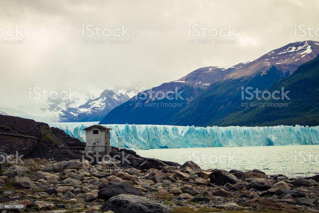 Argentina, El Calafate, South America - Small house in landscape of the glacier Perito Moreno. royalty-free stock photo
