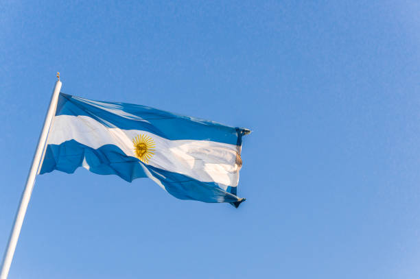 Argentina flag waving against blue sky on a sunny day stock photo