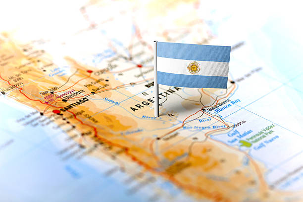 Argentina pinned on the map with flag The flag of Argentina pinned on the map. Horizontal orientation. Macro photography. Argentina stock pictures, royalty-free photos & images